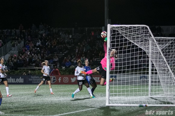 Sky Blue FC goalkeeper Caroline Casey (27) gets a hand on the ball and looks on as the ball hits the post