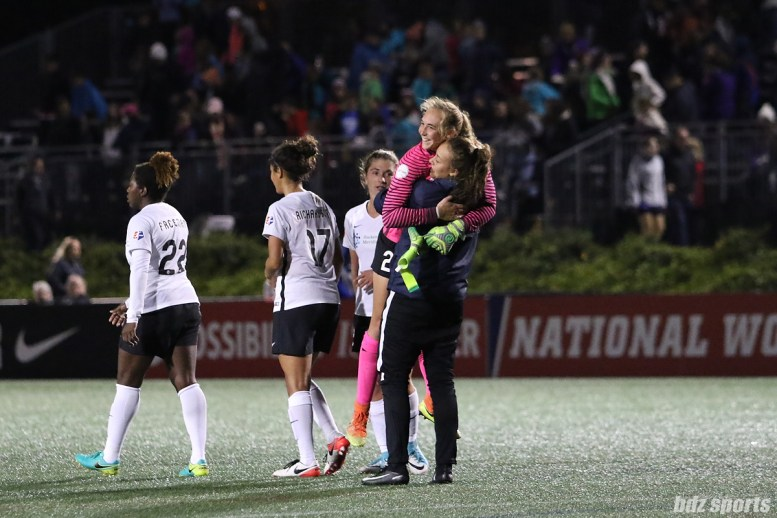 Sky Blue FC goalkeeper Caroline Casey (27) receives a hug from fellow goalkeeper Kailen Sheridan