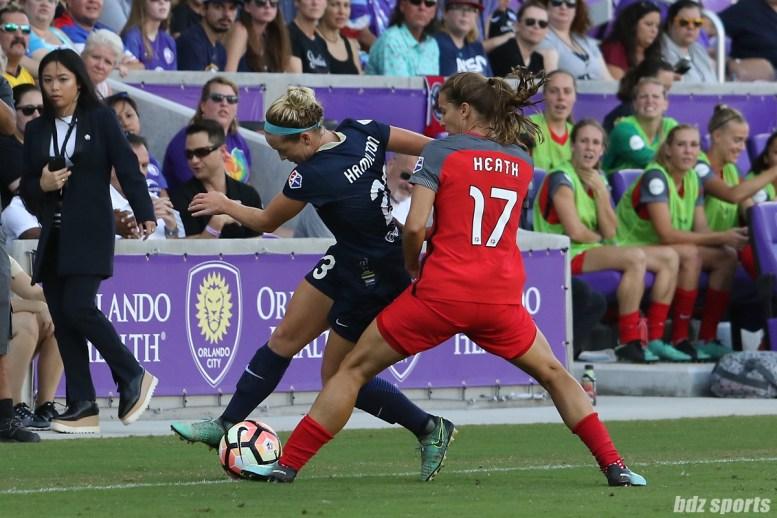 Portland Thorns FC midfielder Tobin Heath (17) challenges North Carolina Courage forward Kristen Hamilton (23) for the ball