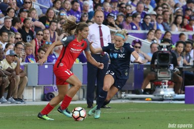 Portland Thorns FC midfielder Tobin Heath (17) controls the ball while North Carolina Courage forward Kristen Hamilton (23) defends