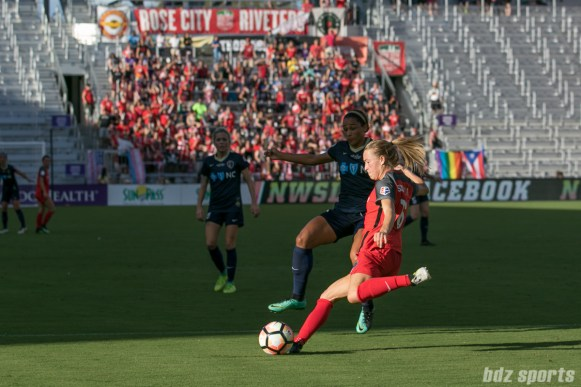 Portland Thorns FC defender Emily Sonnett (16) clears the ball out for Thorns