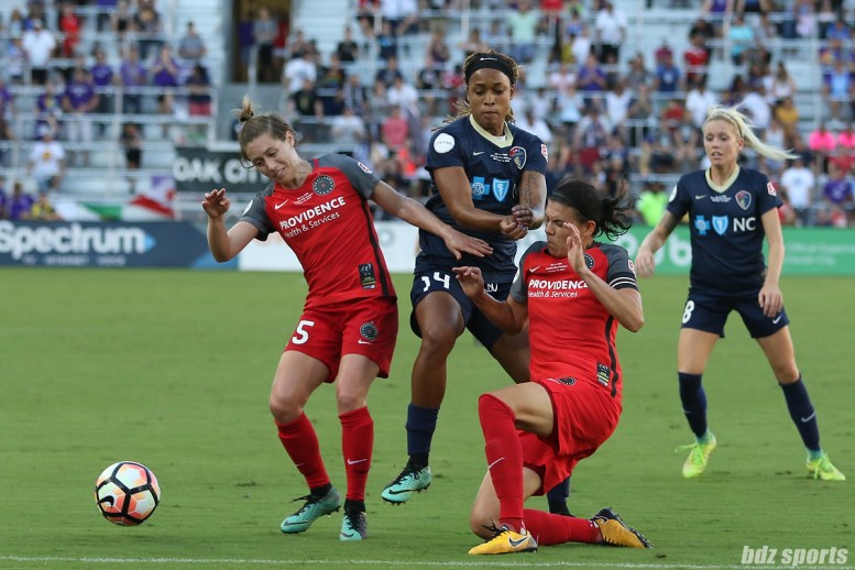 Portland Thorns FC forward Christine Sinclair (12) and defender Meghan Klingenberg squeeze out North Carolina Courage forward Jessica McDonald (14) from the ball