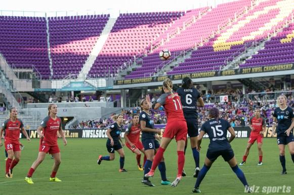 Portland Thorns FC midfielder Dagny Brynjarsdottir (11) and North Carolina Courage defender Abby Erceg (6) battle for the ball
