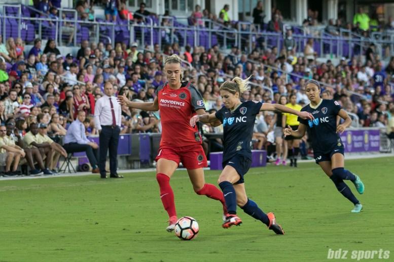 Portland Thorns FC midfielder Dagny Brynjarsdottir (11) and North Carolina Courage midfielder McCall Zerboni (7) both go for the ball