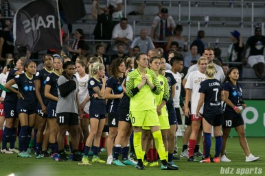 The North Carolina Courage wait for the trophy presentation to begin