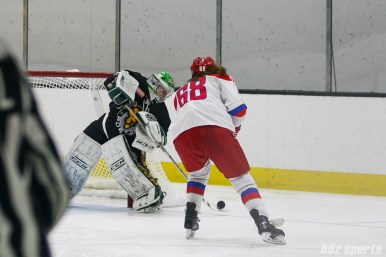 Boston Pride goalie Madison Litchfield (30) looks to clear the puck