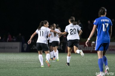 Sky Blue FC forward Sam Kerr (20) slaps hands with teammate Sky Blue FC midfielder Raquel Rodriguez (11) after scoring her 17th goal of the season