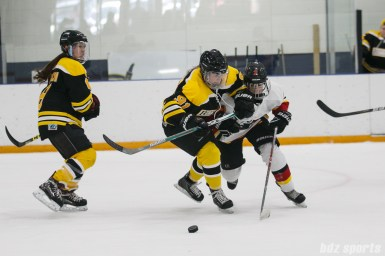Boston Blades defender Jordan Hampton (91) looks to fend off Calgary Inferno forward Laura Dostaler (2)