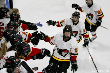 Calgary Inferno defender Taryn Baumgardt (12) high fives teammates after a goal