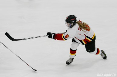 Calgary Inferno defender Megan Grenon (6) takes a shot on goal