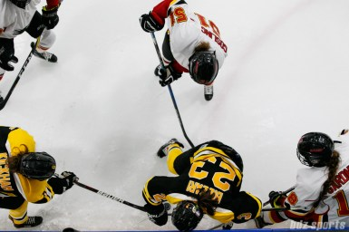 Boston Blades forward Melissa Bizzari (23) looks to gain control of the puck