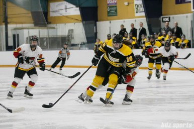 Boston Blades forward Kaitlin Spurling (16) looks to fend off Calgary Inferno defender Katelyn Gosling (51)
