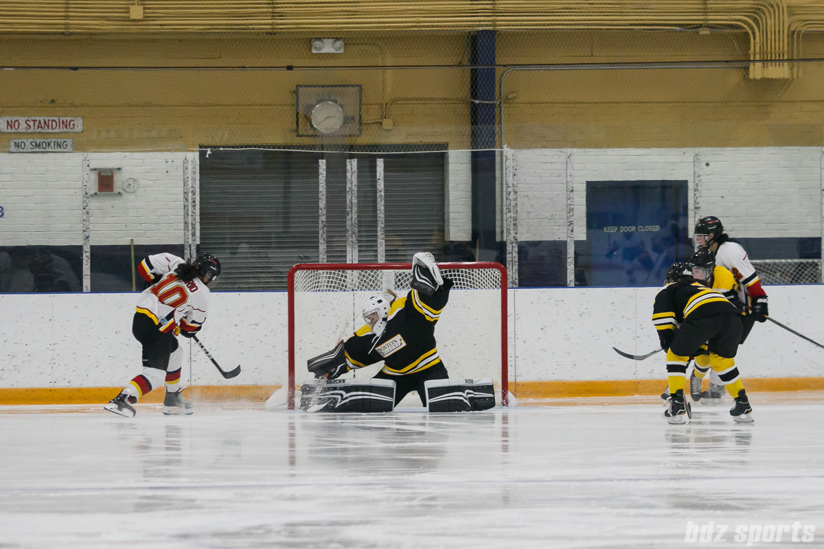 Boston Blades goalie Jetta Rackleff (21) comes up with the stop against Calgary Inferno forward Rhianna Kurio (10)