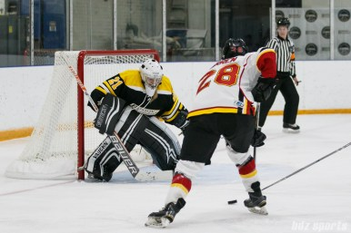 Calgary Inferno forward Louise Warren (28) takes on Boston Blades goalie Jetta Rackleff (21)