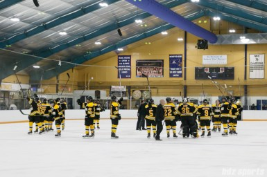 The Boston Blades acknowledge fans at the end of their 5 - 2 loss against the Calgary Inferno