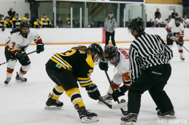 Boston Blades forward Courtney Turner (3) faces off against Calgary Inferno forward Iya Gavrilova (25)
