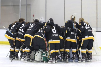 The Boston Pride huddle before the start of the game