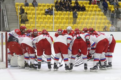 The Russian team huddles after the game