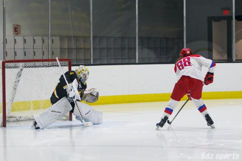 A Russian player takes on Boston Pride goalie Brittany Ott (29) 1-versus-1 on a breakaway