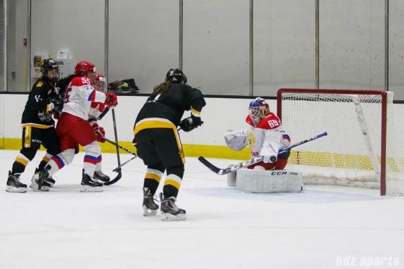 Russian team goalie Mariia Sorokina (69) uses her pad to push the puck away
