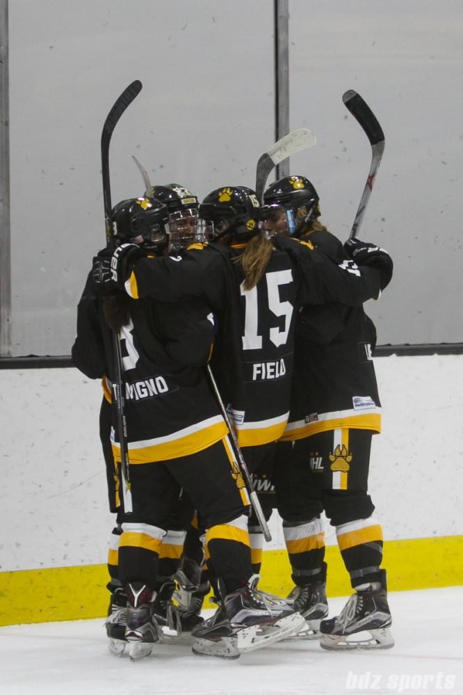 Boston Pride players Dana Trivigno (8), Emily Field (15), and Alexandra Bender (5) celebrate Haley Skarupa's (22) goal