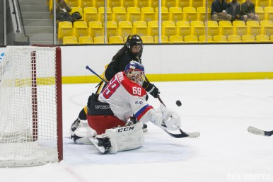 Russian team goalie Mariia Sorokina (69) looks to grab the puck out of the air