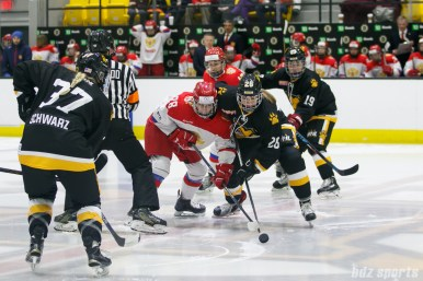 Boston Pride forward Janine Weber (26) battles a Russian player for control of the puck