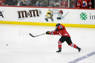 A Metropolitan Riveters player takes a shot on goal