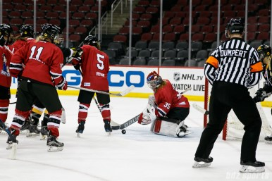 Metropolitan Riveters goalie Katie Fitzgerald (35) tracks a loose puck in front of the Riveters goal