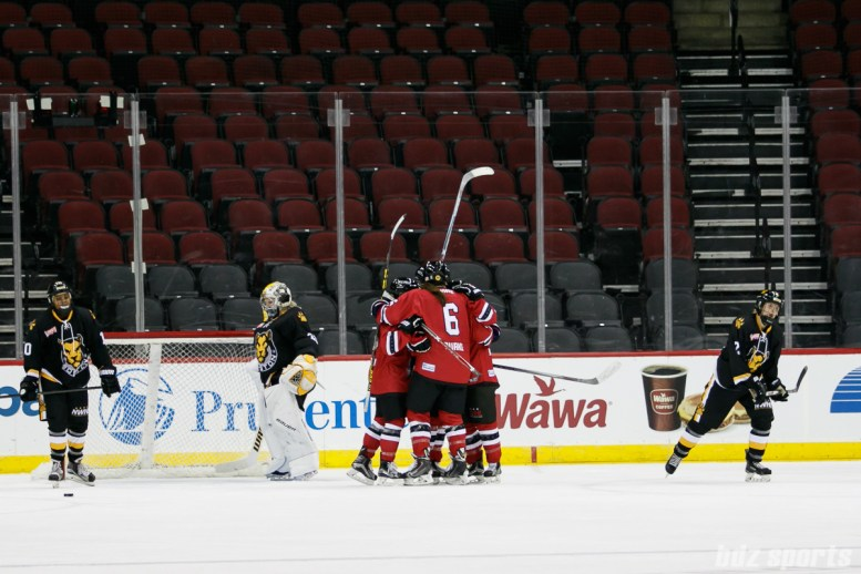 The Metropolitan Riveters celebrate Alexa Gruschow's goal in the second period