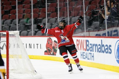 Metropolitan Riveters forward Rebecca Russo (18) celebrates her goal and the Riveters fourth goal of the game