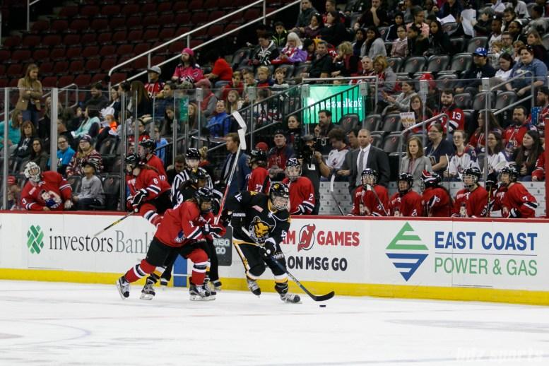 Boston Pride defender Marissa Gedman (12) brings the puck down the ice