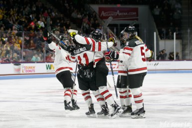 Team Canada celebrates Laura Fortino's (8) second period goal