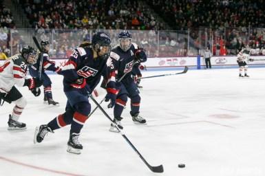 Team USA forward Alex Carpenter (25) controls the puck for Team USA