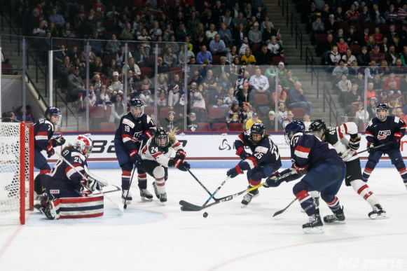 The puck is loose in front of Team USA goal