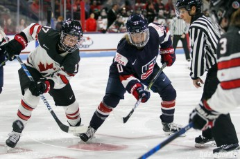 Team Canada forward Bailey Bram (17) and Team USA forward Hannah Brandt (20)