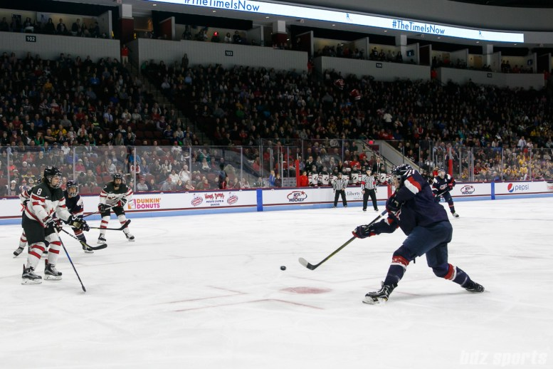 Team USA forward Hilary Knight (21) takes a shot on goal