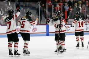 Team Canada captain Marie-Philip Poulin (29) fist bumpbs teammate Lauriane Rougeau (5)