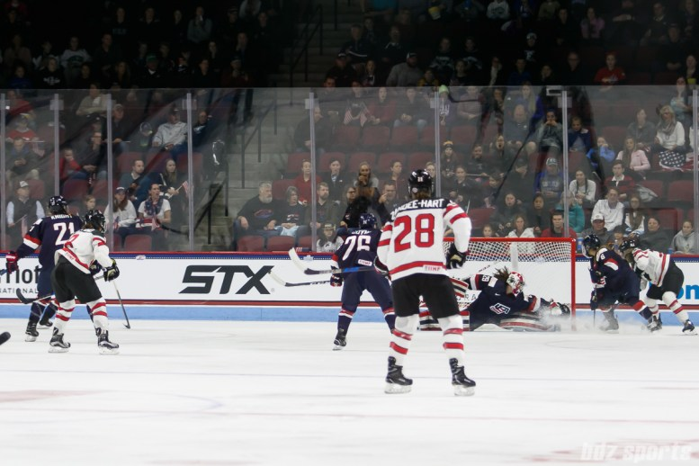 Team Canada forward Natalie Spooner (24) beats Team USA goalie Nicole Hensley (29) to score the first goal of the game