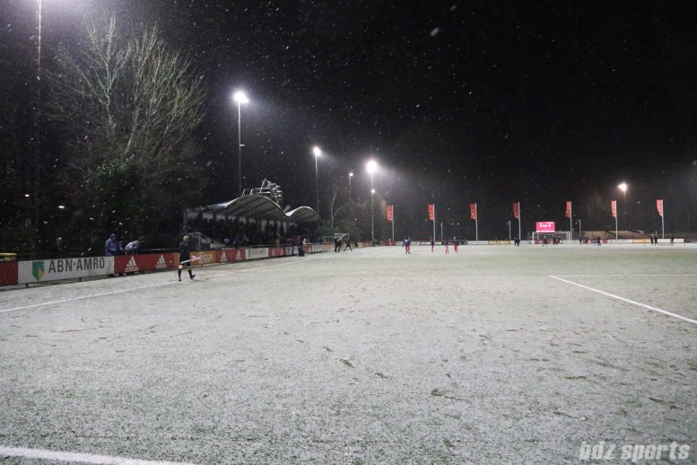 Snow and hail fall during pre-game warm ups prior to the Ajax vs FC Twente soccer game at Sportpark de Toekamst