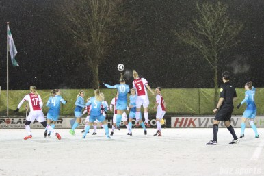 Ajax defender Stefanie van der Gragt (3) heads the ball over FC Twente midfielder Jassina Blom (10)