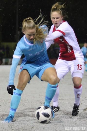 FC Twente defender Kika van Es (5) shields the ball from Ajax forward Linda Bakker (15)