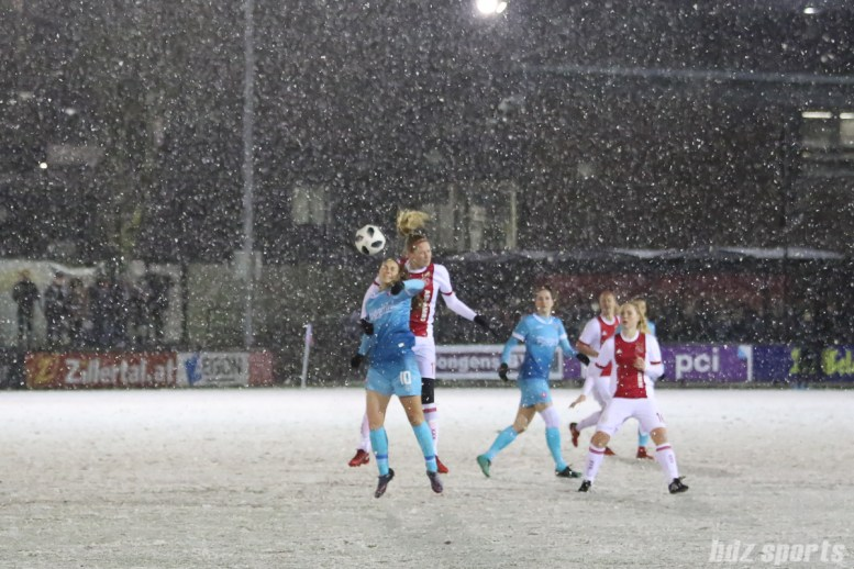 Ajax defender Kelly Zeeman (17) heads the ball over FC Twente midfielder Jill Roord (10)