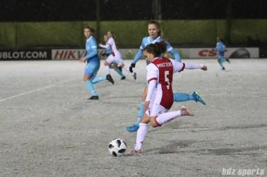 Ajax defender Davina Philtjens (5) takes a shot on goal