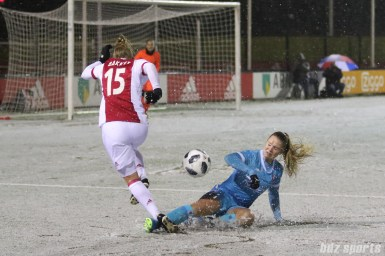FC Twente defender Kika van Es (5) slide tackles the ball away from Ajax forward Linda Bakker (15)