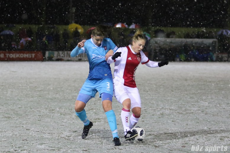 Ajax forward Linda Bakker (15) controls the ball for Ajax while being defended by FC Twente defender Myrthe Moorrees (3)