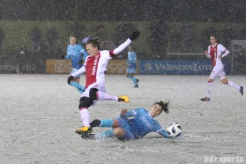 FC Twente defender Myrthe Moorrees (3) slide tackles the ball away from Ajax midfielder Desiree van Lunteren (10)