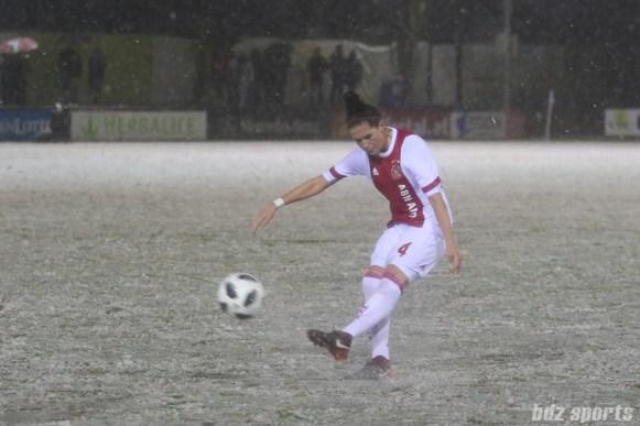 Ajax defender Merel van Dongen (4) sends the ball into the box