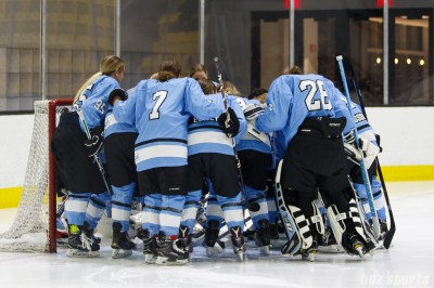 The Buffalo Beauts huddle before their game against the Boston Pride on December 2, 2017 at Warrior Ice Areana
