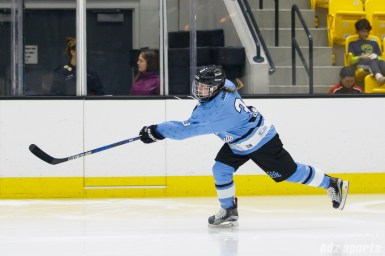 Buffalo Beauts defender Sarah Edney (3) sends the puck down ice
